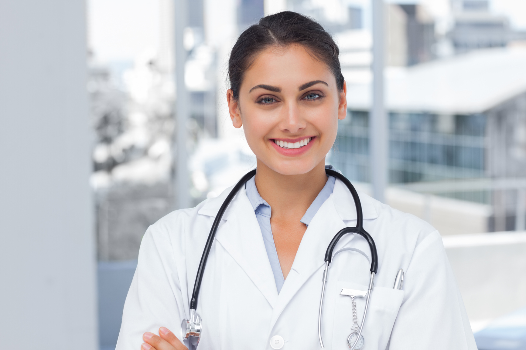 20s, Young Adult, Woman, Female, Caucasian, Indoors, Looking At Camera, Doctor, Practitioner, Profession, Professional, Specialist, Lab Coat, Stethoscope, Confident, Happy, Smile, Smiling, Standing, Clinic, Healthcare, Hospital, Medical, Staff, Attractive, Pretty, Brunette, Portrait