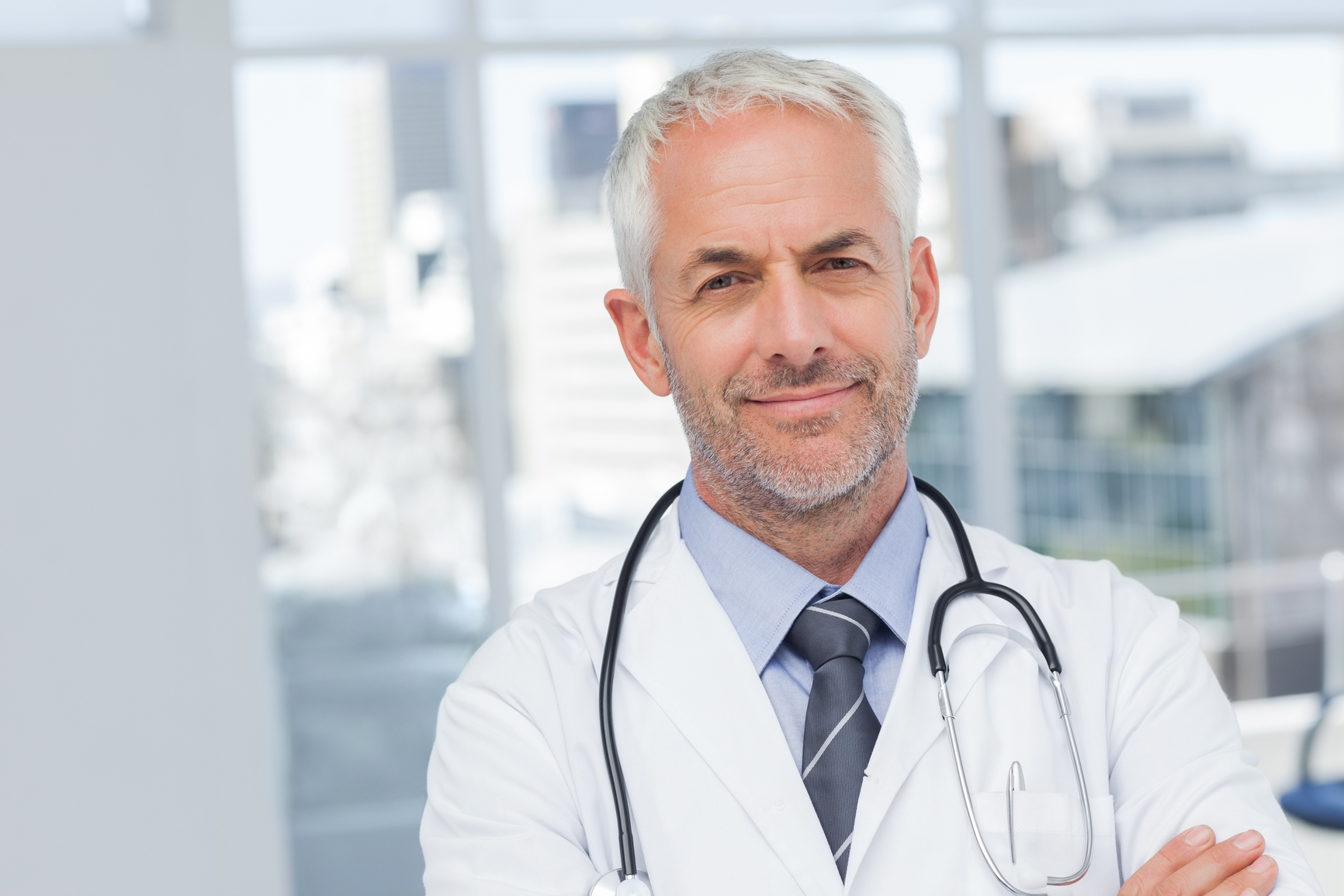 50s, Mature Adult, Man, Male, Caucasian, Indoors, Looking At Camera, Doctor, Practitioner, Profession, Professional, Specialist, Lab Coat, Stethoscope, Confident, Happy, Smile, Smiling, Standing, Clinic, Healthcare, Hospital, Medical, Staff, Attractive, Handsome, Grey Hair, Portrait, Arms Crossed